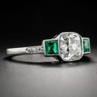 1.73 Carat Antique Cushion Diamond and Emerald Ring