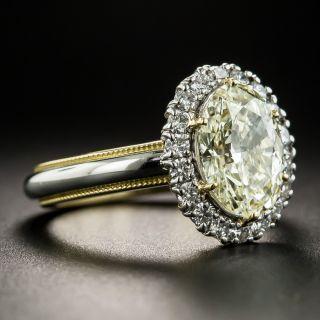 2.11 Carat Light Yellow Oval Diamond Ring GIA