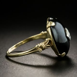 Early Art Deco Onyx and Diamond Ring