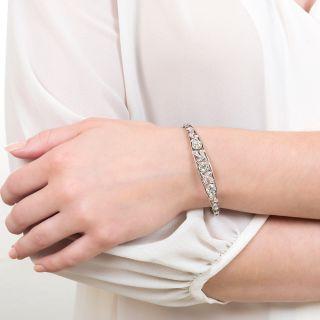 Edwardian Three-Stone Diamond Bangle Bracelet
