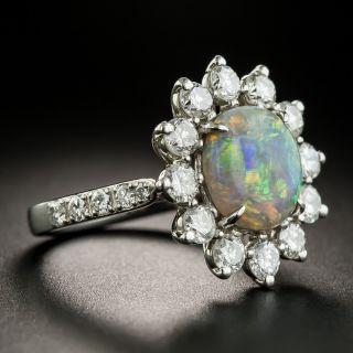 Estate 2.10 Carat Black Opal and Diamond Halo Ring
