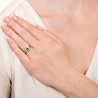 Estate .19 Carat Emerald and Diamond Halo Ring