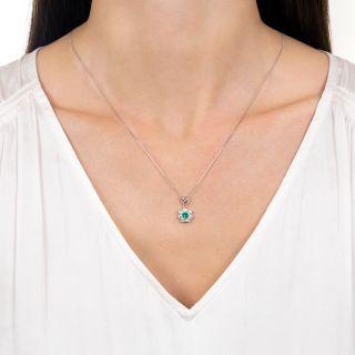 Estate .27 Carat Emerald and Diamond Halo Pendant