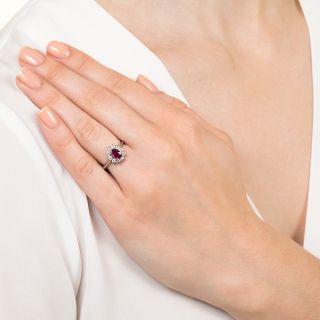 Estate .66 Carat Ruby and Diamond Halo Ring