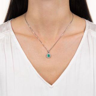Estate .73 Carat Emerald and Diamond Halo Pendant