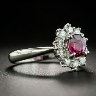 Estate .87 Carat Ruby and Diamond Halo Ring