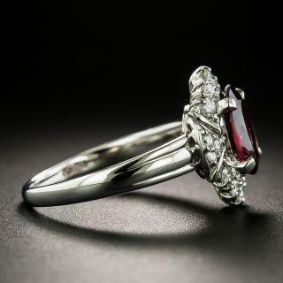 Estate Garnet and Diamond Halo Ring