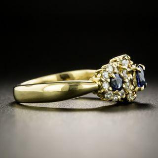 Estate Three-Stone Sapphire and Diamond Halo Ring