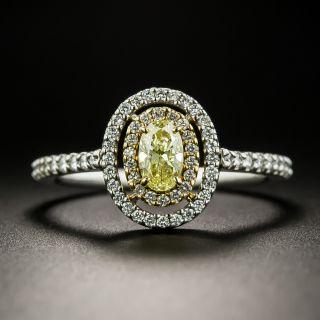 Fancy Yellow .38 Carat Oval-Cut Diamond Halo Ring - 2