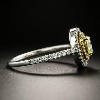 Fancy Yellow .38 Carat Oval-Cut Diamond Halo Ring