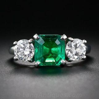 Fine Emerald and Diamond Three-Stone Ring