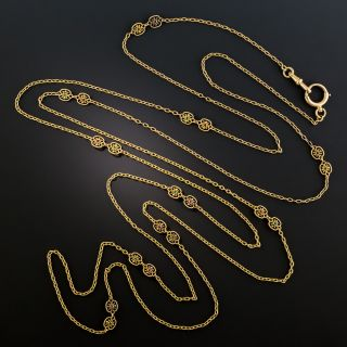 French 18K Gold Long Chain with Emeralds and Rubies