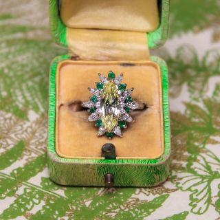 1.96 Carat Light Fancy Yellow MarquiseDiamond and Emerald Ring - GIA