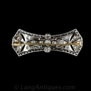 Late Edwardian Platinum Diamond Bow Motif Bar Pin