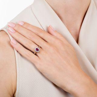 Petite .55 Carat Ruby and Diamond Halo Ring