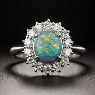 Platinum Black Opal and Diamond Halo Ring