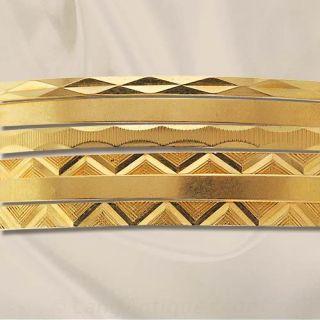 Six Gold Bangles